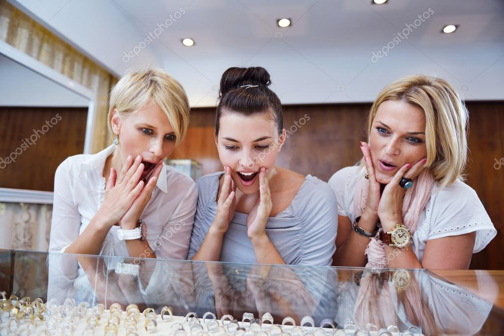 Happy girls group  have fun while shopping in jewelry store — Stock Photo #16803299