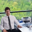 Happy young business man at office — Stock Photo