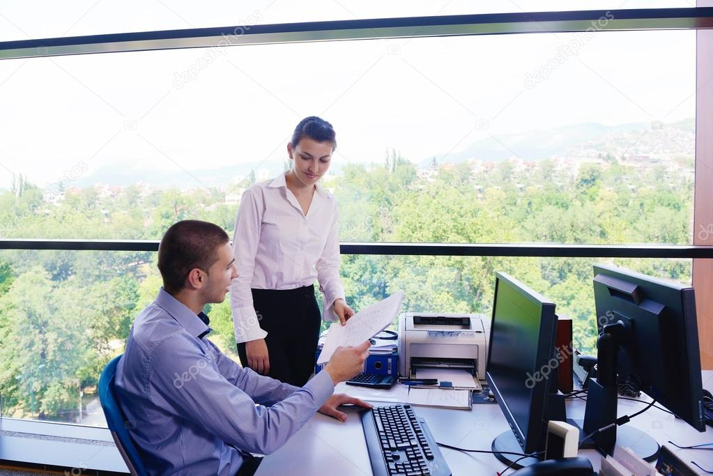 Group of happy young  business in a meeting at office  Stock Photo #16942069