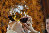 Hands holding the glasses of champagne and wine — Stock Photo