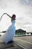 Asian bride on beach — Stock Photo