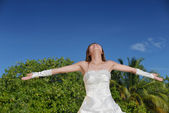 Asian bride on beach — Stock Photo