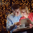 Young couple with a tablet computer - Stockfoto