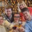Group of happy young drink wine at party — Stock Photo #19445341