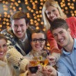 Group of happy young drink wine at party — Stock Photo