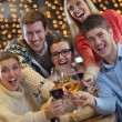 Stock Photo: Group of happy young drink wine at party