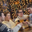 Group of happy young drink wine at party — Stock Photo #19446071