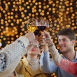 Group of happy young drink wine at party — Stock Photo #19446929