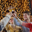 Group of happy young drink wine at party — Foto de Stock