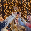 Group of happy young drink wine at party — Stock Photo #19447831