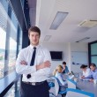 Business man  on a meeting in offce with colleagues in backgroun - Stock Photo