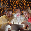 Stock Photo: Happy girls group looking at a pc tablet