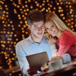 Stock Photo: Young couple with a tablet computer