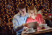 Young couple with a tablet computer — Stock Photo
