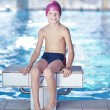 Happy child on swimming pool - Stock Photo