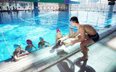 Happy children group at swimming pool — Foto de Stock