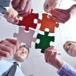 Group of business assembling jigsaw puzzle - Stock Photo