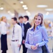 Business woman with her staff in background at office — Stock Photo #21023371