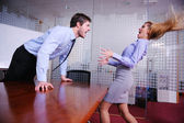 Angry busines sman screaming at employee — Stock Photo