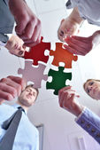 Group of business assembling jigsaw puzzle — Stok fotoğraf