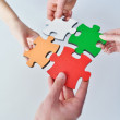 Group of business assembling jigsaw puzzle — Stock Photo #21464341