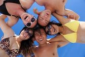 Group of happy young have fun on bach — Stock Photo