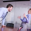 Angry busines sman screaming at employee - Stock Photo