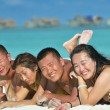 Group of happy young have fun on bach — Stockfoto