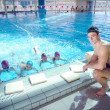 Happy children group at swimming pool — Stock Photo #23768141