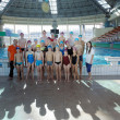 Happy children group  at swimming pool - Stock Photo