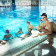 Happy children group at swimming pool — Stock Photo #23770139