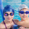 Happy children group at swimming pool — Stock Photo #24705395