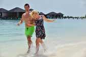 Happy young couple at summer vacation have fun and relax — Foto Stock