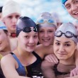 Happy teen group  at swimming pool — Stock fotografie