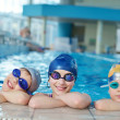 Happy children group  at swimming pool — Stock Photo
