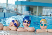 Happy children group at swimming pool — Foto Stock