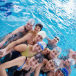Happy teen group  at swimming pool - Stock Photo