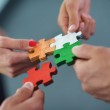 Group of business assembling jigsaw puzzle — Stock Photo