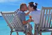 Happy young couple relax and take fresh drink — Stock Photo