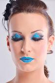 Vacker kvinna med lyxiga makeup — Stockfoto