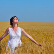 Young woman in wheat field at summer — Stock Photo #27472311