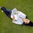 Young woman reading a book in the park — Stock Photo #28031085
