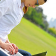 Woman with laptop in park — Stock Photo #28080711
