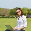 Woman with laptop in park — Stock Photo #28080951