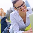 Woman with laptop in park — Foto Stock