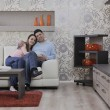 Couple relax at home on sofa — Stock Photo #2845953