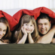 Happy family relaxing in bed — Stock Photo #2856760