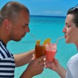 Happy young couple relax and take fresh drink — Stock Photo #29743399