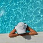 Happy woman in swimming pool — Stock Photo