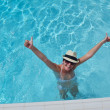 Happy woman in swimming pool — Stock Photo #29812883
